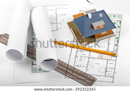 housing development, new real estate project, house on blueprints - stock photo