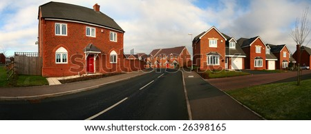 Housing estate in Cannock in England. Panoramic image of road and modern houses - stock photo