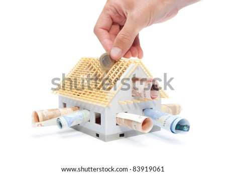Housing finance, building savings and realty financing (investments) concept. Money and model of the family house. - stock photo
