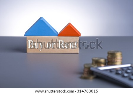 Housing Loan concept. House Wooden Block, coins and calculator with word Buy or Rent  - stock photo