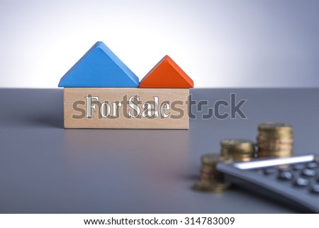 Housing Loan concept. House Wooden Block, coins and calculator with word For Sale  - stock photo