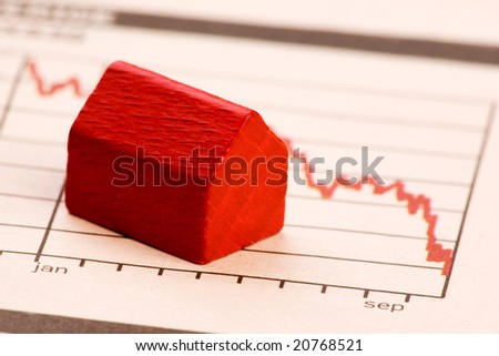 Housing market concept image with graph and toy house - stock photo