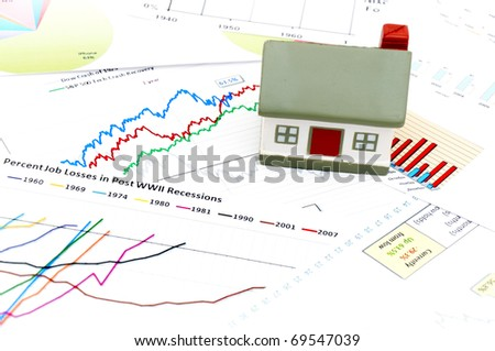 Housing market concept image with graph and toy house