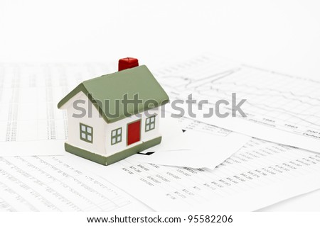 Housing market concept image with graph on chart background - stock photo