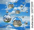 Housing market troubles represented by bubble houses about to burst - stock vector