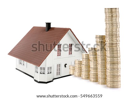 Housing prices going up concept with stack of coins isolated on white background.