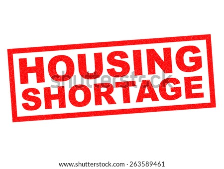 HOUSING SHORTAGE red Rubber Stamp over a white background. - stock photo