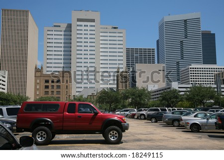 Houston as seen from a parking lot with cars(Release Information: Editorial Use Only. Use of this image in advertising or for promotional purposes is prohibited.) - stock photo