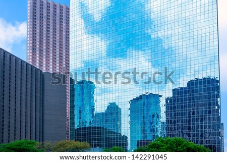 Houston downtown skyscrapers disctrict with mirror blue sky reflection - stock photo