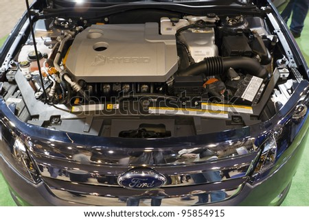 HOUSTON - JANUARY 2012: The Ford Focus Hybrid Engine at the Houston International Auto Show on January 28, 2012 in Houston, Texas. - stock photo