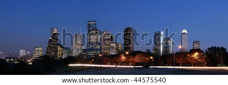 Houston Skyline at Night with Allen Parkway in the foreground - stock photo