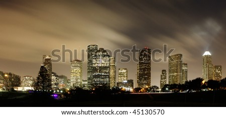 Houston Skyline at night with beautifully lighted clouds - stock photo