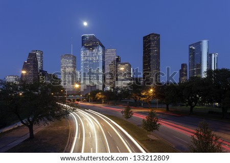 Houston Skyline at Night with Moving Traffic, Texas, USA - stock photo
