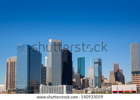 Houston Texas downtown skyscrappers skyline on blue sky day - stock photo
