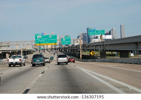 HOUSTON, TEXAS - MAR 24: Cars go to city center, March 24, 2008 in Houston, Texas. Almost 40% of households in Houston has access to two or more motor vehicles - stock photo