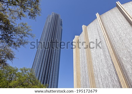 HOUSTON, TEXAS - MARCH 26, 2013: A Water Wall and Williams Tower in Houston, Texas. The Williams Tower is a 64 story near Galleria. It began construction in Aug., 1981 and was completed in Dec., 1982. - stock photo