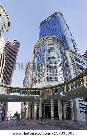 HOUSTON, TEXAS-MARCH 25: Houston Modern Office Building on March 25, 2013 in Houston, Texas.  Chevron Corp. agreed to buy a 50-floor Office Building which used to be the headquarters of Enron Corp. - stock photo