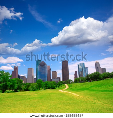 Houston Texas Skyline with modern skyscrapers and blue sky view from park lawn - stock photo