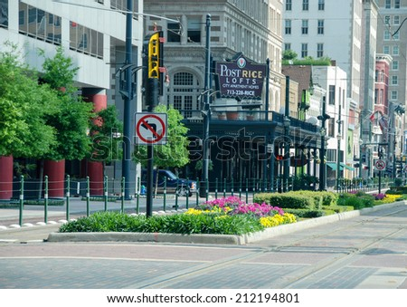 HOUSTON, TX - MARCH 2, 2009: Tourists walk along city streets. Over 7 million international travelers visit the city every year. - stock photo