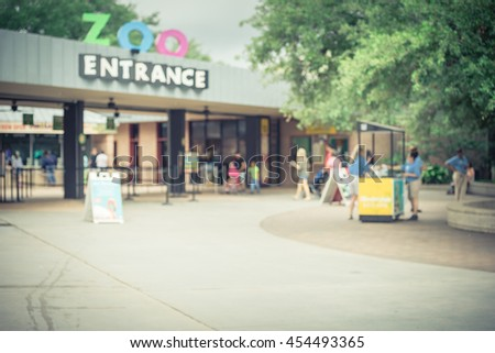 HOUSTON, US-JUN 12, 2016: Visitors entering the Houston Zoo, a 55-acre zoological park located in Hermann Park, Houston, Texas. It houses over 6,000 animals, and receives 1.8 million visitors per year - stock photo