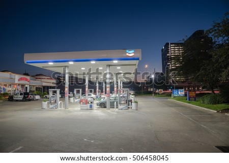 HOUSTON, US-OCT 28, 2016:Chevron gas station and convenience store at blue hour. It is an American multinational energy corporation. The successor of Standard Oil with headquartered in San Ramon, CA.