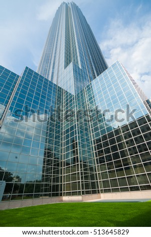 HOUSTON, USA - AUGUST 14; Towering glass curtain wall with architectural reflections of skyscraper modern building know as Williams tower, Galleria district, August 14, 2016, Houston Texas USA