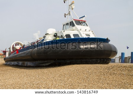 Hovercraft turning for departure on a beach, Southsea, UK - stock photo