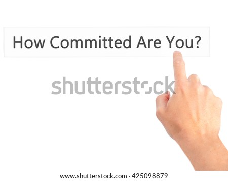 How Committed Are You - Hand pressing a button on blurred background concept . Business, technology, internet concept. Stock Photo - stock photo