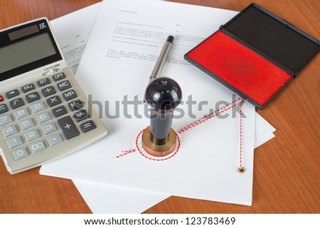 How much will the Notarial Service cost ? - Notary tools on desk - stock photo