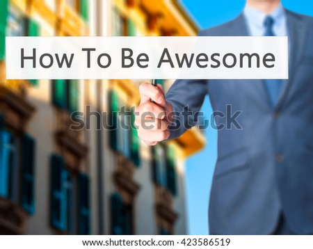 How To Be Awesome - Businessman hand holding sign. Business, technology, internet concept. Stock Photo - stock photo