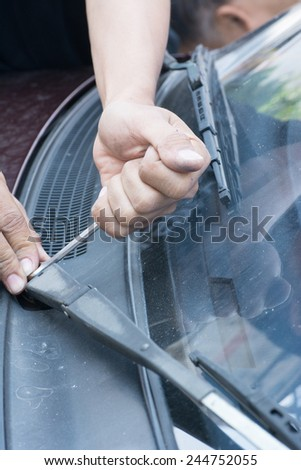 How to Change the Windshield Wipers. - stock photo