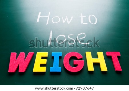 How to lose weight, colorful words on blackboard. - stock photo