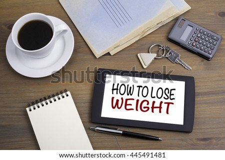How To Lose Weight. Text on tablet device on a wooden table - stock photo