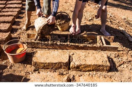 How to make adobe brick. - stock photo