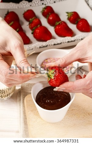 How to make chocolate dipped strawberries - tutorial, step by step - stock photo