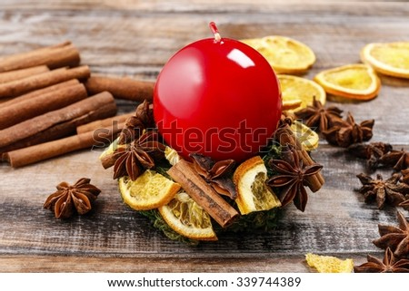 How to make christmas candle holder using moss wreath, cinnamon sticks and dried fruits - step by step, tutorial - stock photo