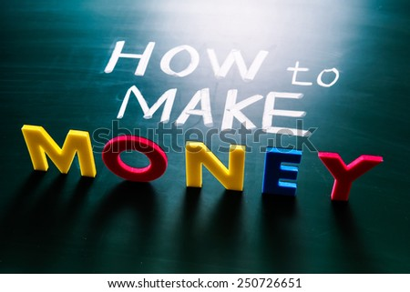 How to make money concept, colorful words on blackboard - stock photo