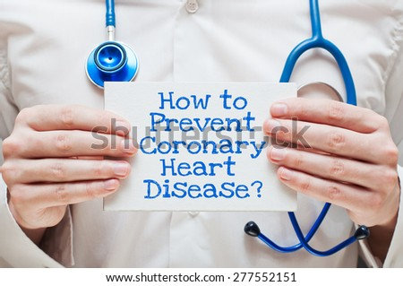 How to Prevent Coronary Heart Disease? Written on a Card in Hands of Medical Doctor - stock photo