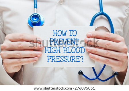 How to Prevent High blood Pressure?  Written on a Card in Hands of Medical Doctor - stock photo
