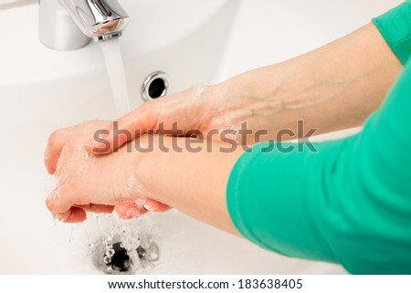 How to wash hands properly - stock photo