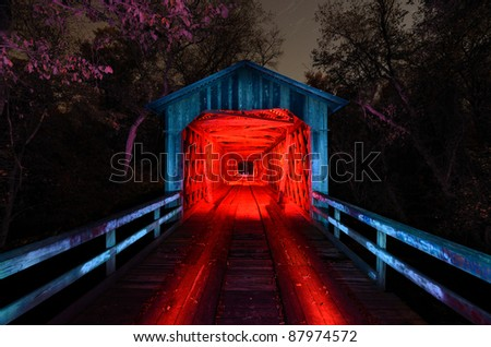 Howards Covered Bridge light painted in Northeast Georgia, USA. - stock photo
