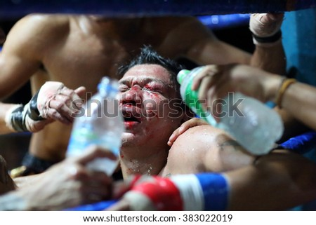 HPA AN - MYANMAR - NOVEMBER 12, 2015: Unidentified traditional Lethwei boxer gets medical treatment at a rural tournament on November 12, 2015 in a village near Hpa An, Myanmar - stock photo