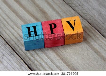 HPV (Human Papillomavirus) acronym on colorful wooden cubes - stock photo