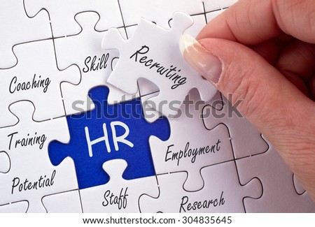 HR - Human Resources - business concept with female hand and puzzle - stock photo
