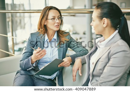 Hr manager asking questions to female candidate - stock photo