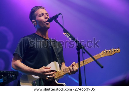 HRADEC KRALOVE - JULY 5: Guitarist Thom Powers of The Naked and Famous during performance at festival Rock for People in Hradec Kralove, Czech republic, July 5, 2014. - stock photo