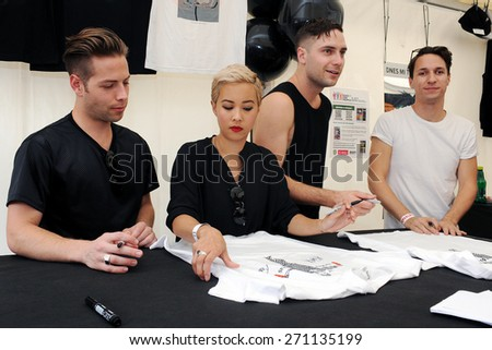 HRADEC KRALOVE - JULY 5: Members of The Naked and Famous band during signing to fans at festival Rock for People in Hradec Kralove, Czech republic, July 5, 2014.