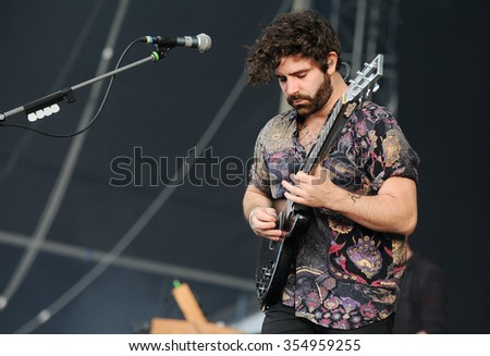 HRADEC KRALOVE - JULY 4: Singer and guitarist Yannis Philippakis of English band Foals during performance at festival Rock for People in Hradec Kralove, Czech republic, July 4, 2013. - stock photo