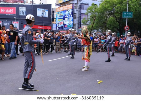 Hsinchu, Taiwan -2015-aug 27: The Messenger of God, face painting in Hsinchu, Taiwan to stop the fierce ghost firecrackers in Ghost Festival August 27