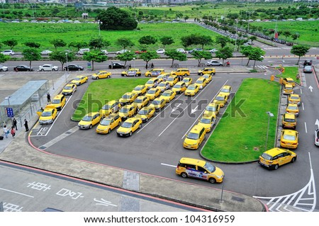 HSINCHU, TAIWAN - JUNE 2: Taxis wait outside the Hsinchu High Speed Rail Station on June 2, 2012. Low passenger load factor now making cab drivers having a hard time. - stock photo